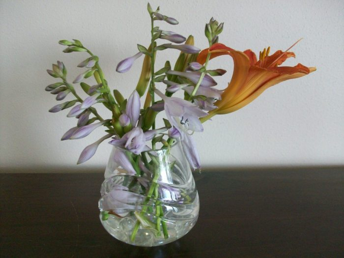 Flowers in a small vase of water